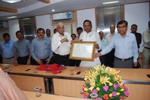 Honble Minister of Steel being handed over the ISO 9001 certificate for the Ministry of Steel