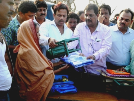 'Aseema Odisha' Officials in Relief distribution in a Phailin hit Village in Ganjam District