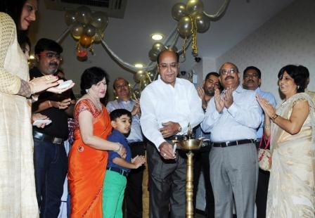 Inauguration of Khimji Jewellers Rourkela Store - Mr. Dinesh Khimji lighting the lamp to mark the occasion