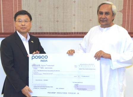 Photo - POSCO India CMD Mr. Y W Yoon Hands Over Rs 1 crore to Honourable Chief Minister of Odisa for Relief & Restoration Work (1)