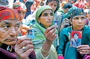 Women displaying photos of relatives killed in Machil fake encounter