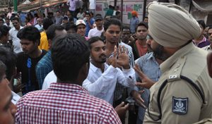 DCP Nitinjeet Singh trying to pacify the crowd after post-poll violence in Rental Colony area
