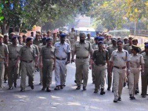 Police stage flag march in Rental Colony