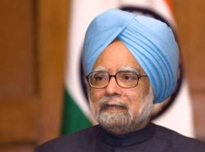 India's Prime Minister Manmohan Singh speaks during a news conference in Washington November November 25, 2009. Singh said on Wednesday that he saw no major hurdles to quickly implementing a bilateral civil agreement with the United States that would open up India's potential $150 billion market in power plants.    REUTERS/Molly Riley  (UNITED STATES POLITICS BUSINESS)