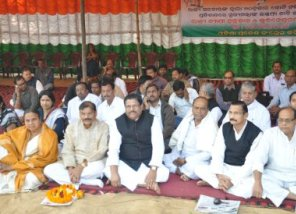 Congress leaders on a dharna at PMG Square