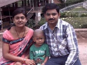 Sahu with wife and son