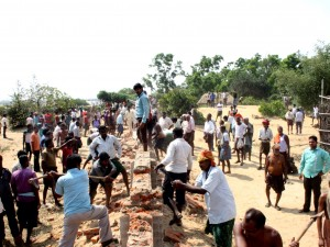 Nuagaon villagers pulling down boundary wall ( pic-Binay K Ray )