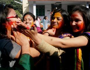 Students of Banaras Hindu University (BHU) celebrate Holi at the university campus in Varanasi on March 16, 2014. (Photo: IANS)