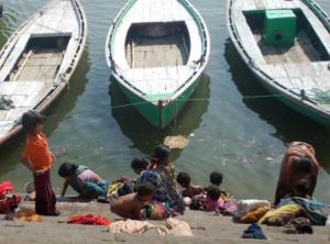 Women washing clothes on the ghats of Ganga in Varanasi -IANS pic