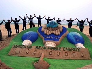 Sand sculpture by Sudarsan Pattnaik celebrating Earth Hour