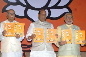 BJP veteran L K Advani, party president Rajnath Singh, party's Prime Ministerial candidate and Gujarat Chief Minister Narendra Modi and senior party leader Murli Manohar Joshi release BJP's manifesto for 2014 Lok Sabha Elections in New Delhi on April 7, 2014. (Photo: IANS)