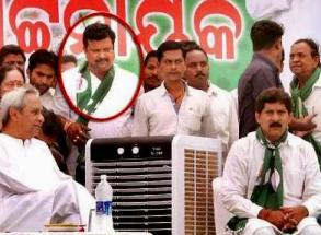 Samantray on dais at a BJD meeting in Tangi on April 11, 2014