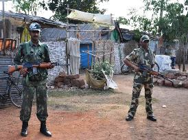 Armed personnel guarding a slum area in Bhubaneswar