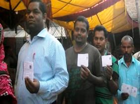 Voters in a booth in Phulbani