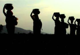 Women in a village in Odishs carrying  water from a river (IANSpic)