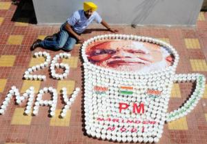 A miniature artist creates a picture of Prime Minister-designate Narendra Modi with glasses used for serving tea to congratulate him ahead of his swearing-in ceremony, in Amritsar (Photo: IANS)