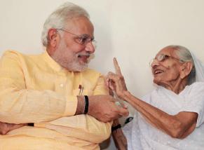 Modi with his mother Heeraben  (Photo: IANS)