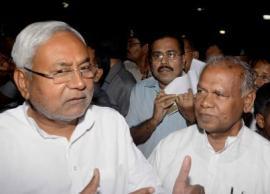Newly elected Bihar Chief Minister Jitan Ram Majhi with JD-U leader Nitish Kumar (IANS)