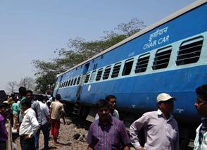 The derailed bogies of Diva-Sawantwadi express near Nagothana in Raigarh of Maharashtra on May 4, 2014.  (Photo: IANS)