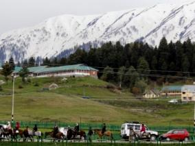 Tourists enjoy themselves in Gulmarg of Jammu and Kashmir on June 3, 2014. (Photo: IANS)