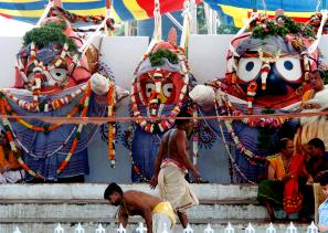 Lord Jagannath, Lord Balabhadra and Devi Subhadra given a bath during a special ritual ``Devasnana Purnima`` at Jagannath temple in Puri on June 13, 2014. (Photo: IANS)