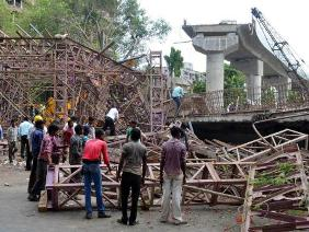 An under-construction flyover collapses in Surat on June 10, 2014. (Photo: IANS)