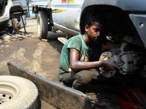 Child mechanic at work in a garage ( IANS pic)