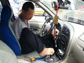 The armless Chinese driver ( source : dailymail.co.uk)