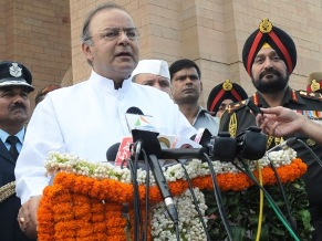 The Union Minister for Finance, Corporate Affairs and Defence, Shri Arun Jaitley addressing after laying wreath at Amar Jawan Jyoti, on the occasion of Kargil Vijay Diwas, in New Delhi on July 26, 2014. 	The Chief of Army Staff, General Bikram Singh, the Chief of Naval Staff, Admiral R.K. Dhowan and the Chief of the Air Staff, Air Chief Marshal Arup Raha are also seen.