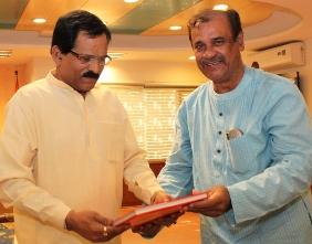 Tourism minister Ashok Panda presenting a book to Union minister Sripad Naik
