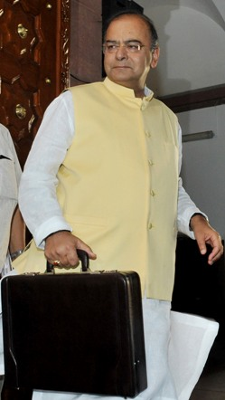 The Union Minister for Finance, Corporate Affairs and Defence, Shri Arun Jaitley arrives at Parliament House to present the General Budget 2014-15, in New Delhi on July 10, 2014.