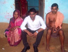 Madan Mohan Mallick (27), who returned from Iraq, with his parents