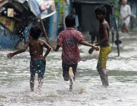 Rain, children . (Photo: Kuntal Chakrabarty/IANS)