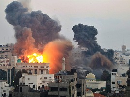 File pic :Gaza city hit by Israeli air strikes ( source-theguardian.com)