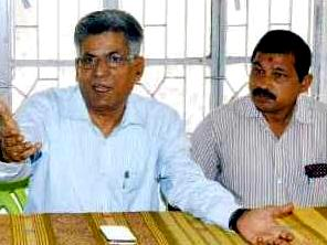 Er Karunakar Supakar (L) addressing the media