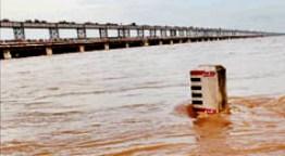 Swelling Mahanadi at Jobra Barrage