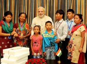 PM Modi with the family of Shri Jeet Bahadur, in Kathmandu (PIB)
