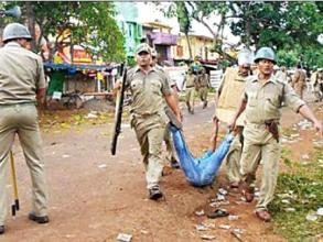 Police dragging the body of the deceased Pradip Behera