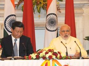 PM Modi addressing joint press meet with Chinese President Xi Jinping (PIB Pic)