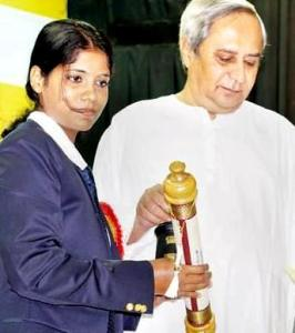 Pratima Puhan being conferred with the Biju Patnaik Award for the Best Sportswoman for the year 2010 by Chief Minister Naveen Patnaik on Friday