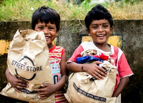 Two kids at The Street Store with their new acquisitions   pic-Raj Sampad
