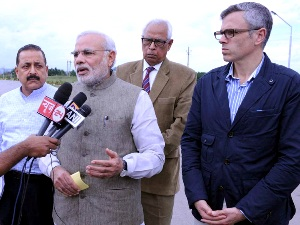 PM Modi talking to media persons in Jammu.  J&K CM Omar Abdullah and Union minister Jitendra Singh  accompanied the PM ( PIB)