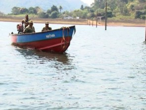 Security personnel on patrol in Gurupriya river