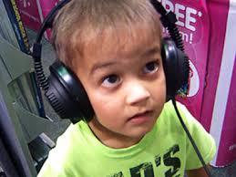 kid listening to something