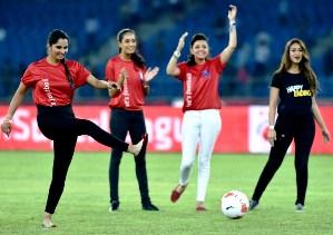 tennis-star-sania-mirza-kicks-a-football-Tennis star Sania Mirza kicking the ball