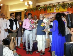 Journalist Chandan Paikray being felicitated for his bravery by Leader of Opposition Narasiingha Mishra on the occasion of the 113th birth anniversary of former Chief Minister Nabakrushna Choudhury on Sunday