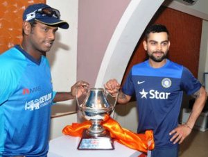Rival Captains Virat Kohli and Angelo Mathews unveiling the trophy for the five-match India-Sri Lanka series ahead of the first match at Barabati on Sunday (Pic: Biswaranjan Mishra)