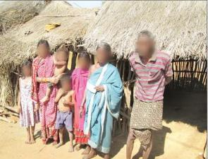 Bibeka's wife Kumari (face blurred) with her son in her lap and other members of the family after her return