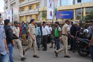 Policemen led by DCP Satyabrata Bhoi at the Bhabani Mall  Pic: Biswaranjan Mishra