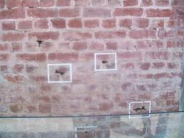 bullet marks on walls